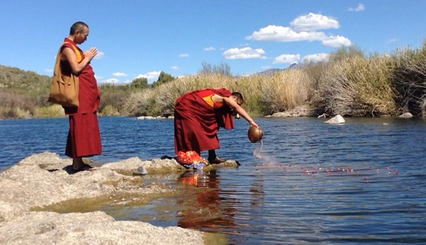 After the mandala is completed, the sands are swept together and dispersed in the waters of a river.