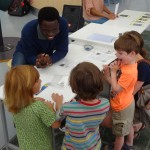 adult working with children at science center