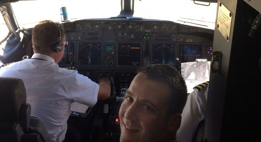 Michael Zilrulnik in the cockpit of an airliner